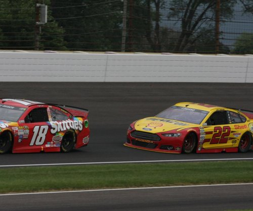 Joey Logano passes Kevin Harvick for win at Watkins Glen