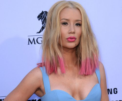 Iggy Azalea extends olive branch to Erykah Badu, feud ends