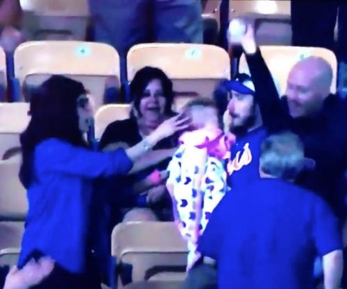 Dad almost drops baby at Los Angeles Dodgers game, catches ball