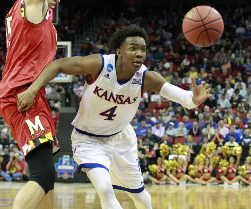 No. 2 Kansas bounces Syracuse behind Devonte' Graham's 35