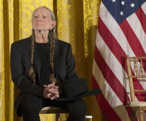 Bono and Willie Nelson collaborating on a song for 'Waiting for the Miracle to Come' film