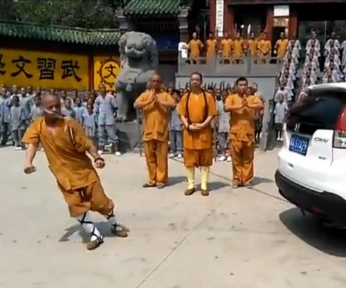 Shaolin monk uses his ear to drag SUV backward