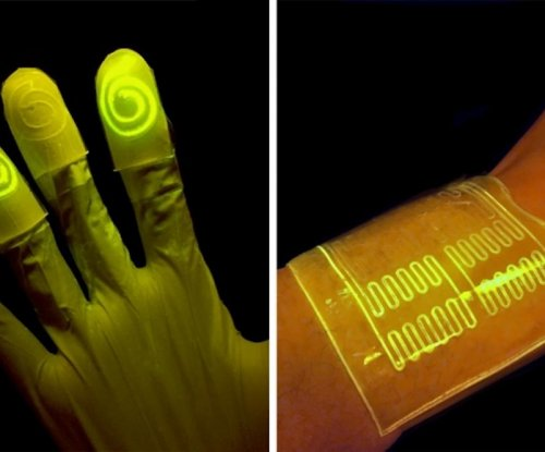 New 'living material' gloves light up when they touch target chemicals