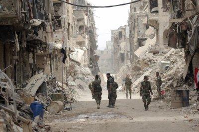 U.S. denies airstrikes that killed dozens of Syrian troops