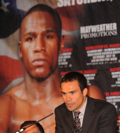 Mayweather injury postpones Marquez fight