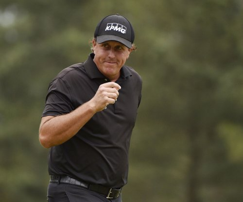 Mickelson withdraws from Match Play