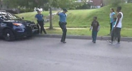 Kansas City cop gets schooled in dance-off with neighborhood kids on video