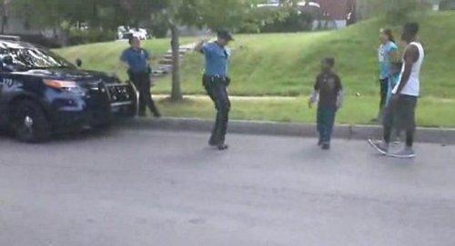 Kansas City cop gets schooled in dance-off with neighborhood kids on video