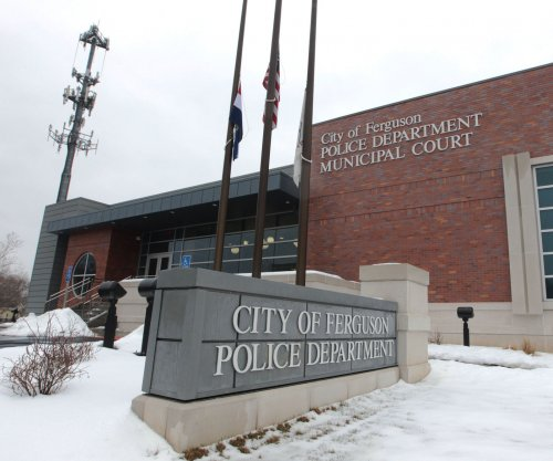 Two Ferguson police officers resign over racist emails