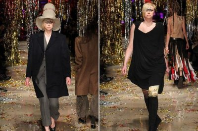 Gwendoline Christie walks the runway at Paris Fashion Week