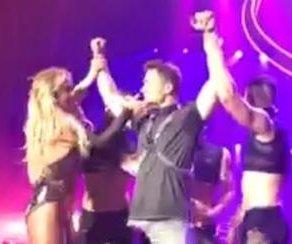Britney Spears brings actor Colton Haynes onstage