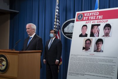 U.S. charges Chinese hackers with attacking companies, pro-democracy groups