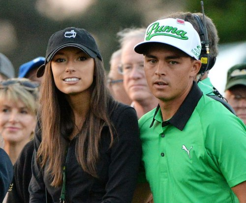 Alexis Randock, Rickie Fowler kiss to celebrate Players win