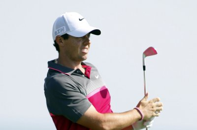 Rory McIlroy trails by two in Dubai after first round