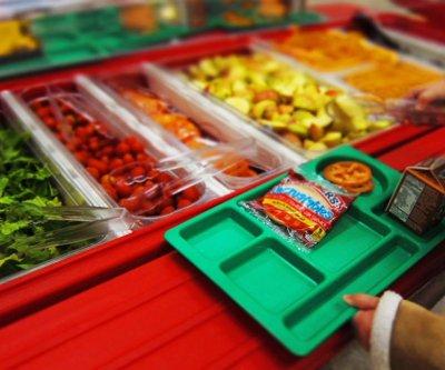 Healthier school meal programs helped poorer kids avoid obesity