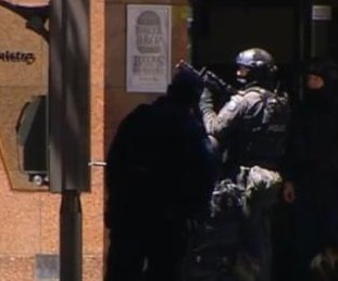 Five hostages flee Sydney cafe as siege continues