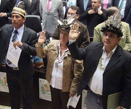 Suspended Venezuelan lawmakers resign to end standoff