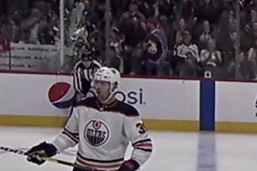 Colorado Avalanche fan shatters penalty box glass