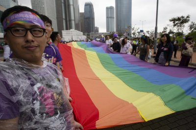 Hong Kong court rules gay couple eligible for spousal benefits