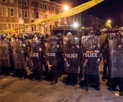 Baltimore wakes to a city in tatters after night of riots, fires