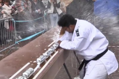 Martial artist crushes world record 77 drink cans with his elbow