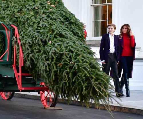 Watch live: Melania Trump, Baron receive Christmas tree