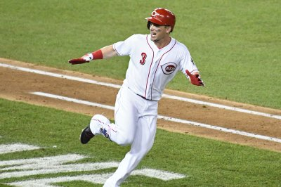 Scooter Gennett helps Reds beat Marlins with 4 RBIs