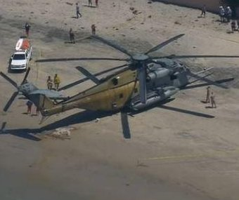 Sunbathers surprised as military chopper lands on Calif. beach