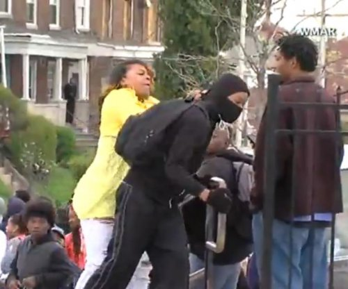 Baltimore rioter gets smacked by mom after seeing him throw rocks at police