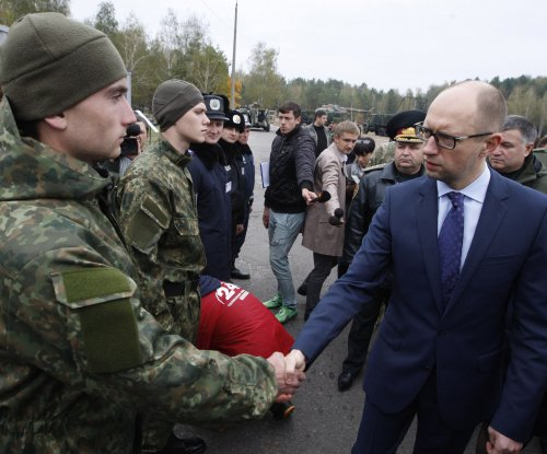 Resignation of Ukraine's Yatsenyuk will mean 'less hysteria'