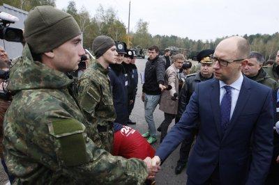 Resignation of Ukraine's Yatsenyuk will mean 'less hysteria'
