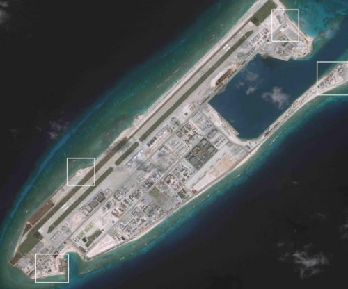 Beijing admits it has installed weapons on islands in the South China Sea