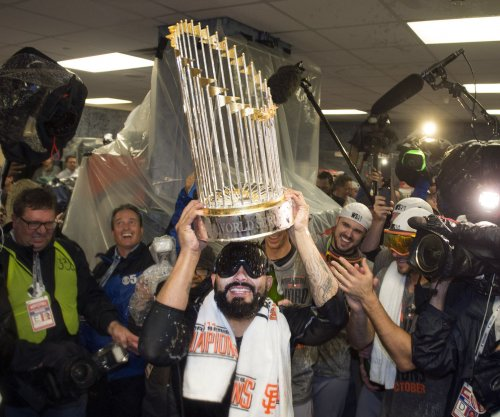 Giants celebrate title before home opener vs. Rockies