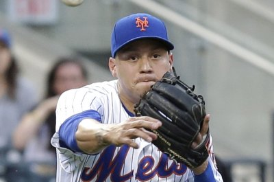 New York Mets infielder Wilmer Flores win arbitration hearing