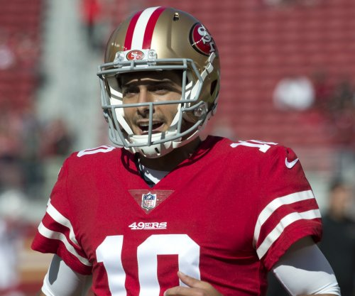 Jimmy Garoppolo shines in 49ers debut, coach says it's not enough to win job