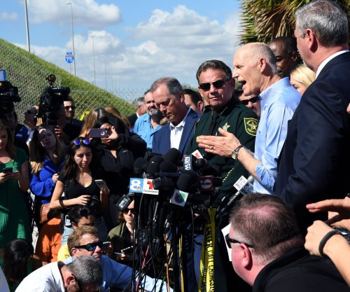 Fla. governor signs school security, gun control bill; NRA sues to challenge