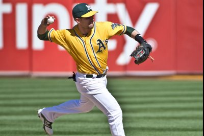 Upwardly mobile A's open series against Tigers