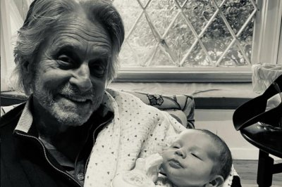 Michael Douglas meets new grandson for the first time