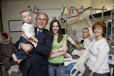 Bush visits Walter Reed patients, has MRI