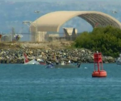 Navy jet goes off runway, splashes into San Diego bay