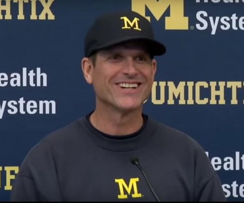 Jim Harbaugh calls criticism of Florida trip 'comical'