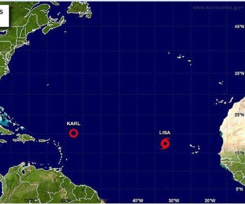 Tropical Storm Lisa strengthens as Karl weakens into depression in Atlantic