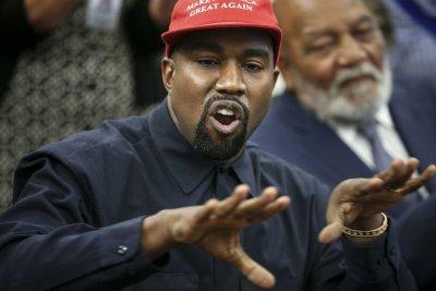 Kanye West delivers shoes to children in Uganda