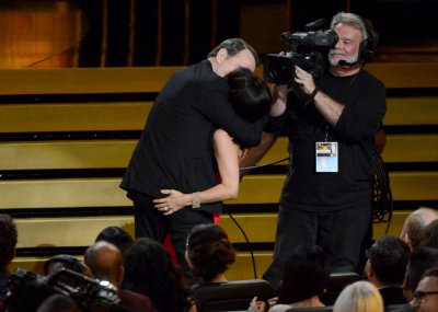 Julia Louis-Dreyfus and Bryan Cranston lock lips in 'Seinfeld' reunion at Emmys