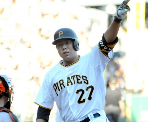 Jung Ho Kang slam helps Pittsburgh Pirates edge Cincinnati Reds