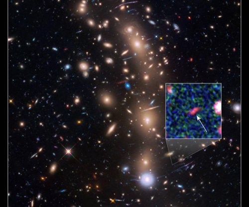 NASA telescopes spot faint compact galaxy from early universe