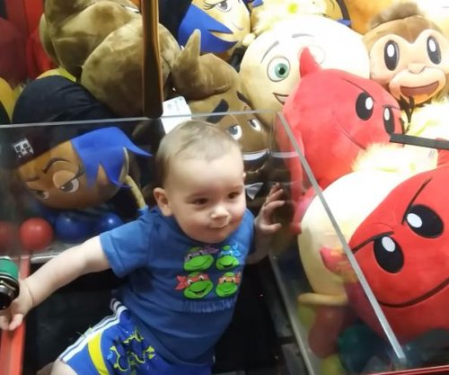 Wandering toddler climbs into claw machine