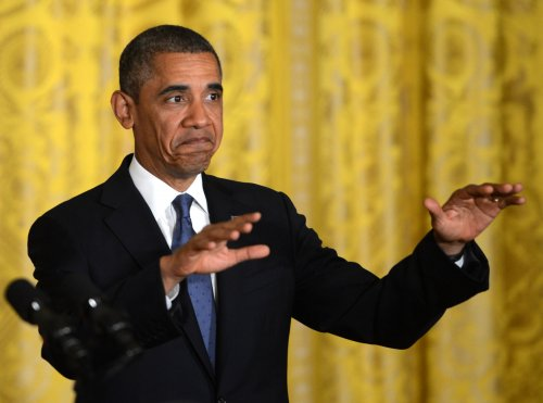 Obama says healthcare law doing what it's supposed to do