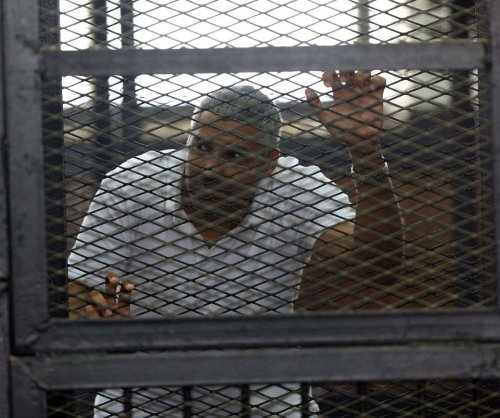 Two of three Al Jazeera journalists pardoned