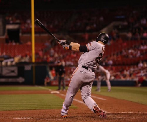 Christian Arroyo's double in 13th helps San Francisco Giants dispatch St. Louis Cardinals